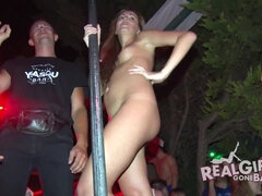 Bad girls put on a strip show on public stange at a night club