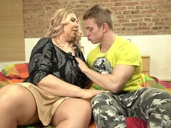 Grannie Dita rides her stud and lets her massive titties flop in his face