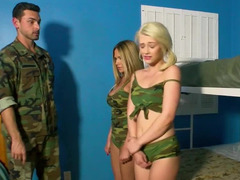 A duo chicks get touched by a dude that has a soldier uniform on