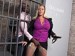 Big-breasted MILF gets blacked in the prison