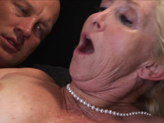 A blonde granny with large tits is getting cumshot in her wet cunt
