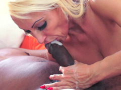 A black guy gets his dick kissed by a hot blonde that loves cock