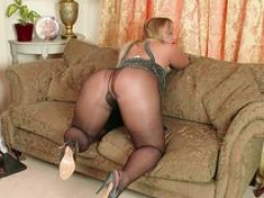 Rotund blonde Beth Bennett wanking dildo toy in shimmering nylon pantyhose and stilettos