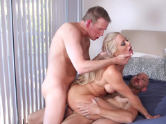 Blonde bitch gets nailed by two handsome porn studs with joy