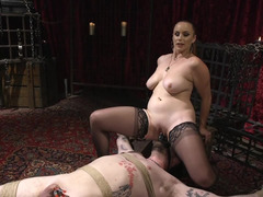 Mistress spanks her submissive and rides a face toy