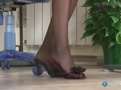 redhead secretary shows off feet in stockings