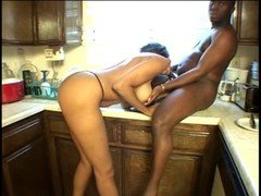 Ebony whore gives her boyfriend a dick sucking in the kitchen