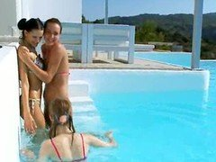 Three chicks blowing off lucky dude in pool