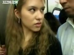 a couple of anthomaniac babes in train gives geek handjob