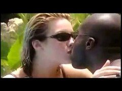 Hot interraical tongue kissing by the pool