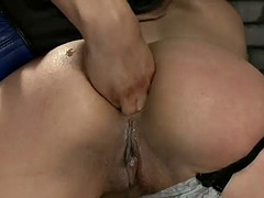 chick gets a fist up her ass in bondage scene