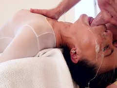 A sweet Asian woman is getting cum in her face close to the camera