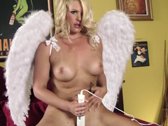 A blonde angel with a nice body is using a vibrator on her wet pussy