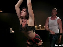 Shemale slave in lingerie gets whipped