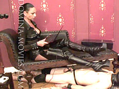 domina tries her perky steel heeled thigh high boots on gimp