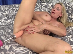 Mature blonde gets fucked by a fucking machine