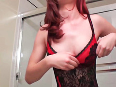 Redhead is undressing and is then riding a hard cock