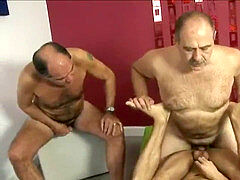 two older men and a youthfull Latino have a 3some