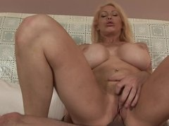 Raunchy blonde Latina slut with a tattooed body rides a big dick