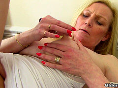 English milf Fiona fondles her pantyhosed snatch