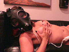 onanism on couch in gas mask