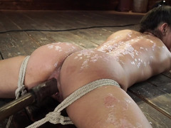 Man reached wet opening of tied up girl and made machine fuck her