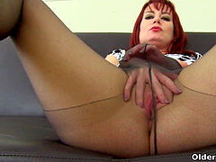 English milf Tanya Cox gets mischievous in stocking