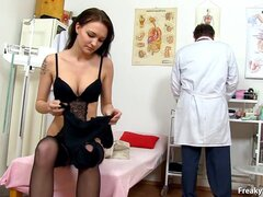 Elderly gyno doctor examines young pussy with toys