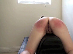 Girl`s ass punished with a crop and spanking paddle