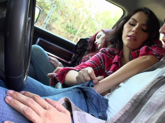 Two girls are in the car, having a ride in the country in a sexy way